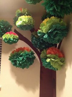 Classroom Decorating Ideas: Fall Foliage Paper poms from the party store easily become bright fall tree foliage. Switch out the green for the red and orange poms, and your students can watch the seasons change
