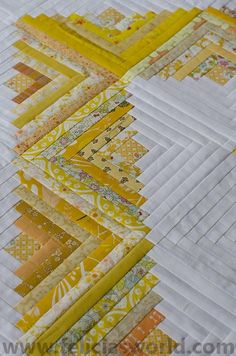 Scrappy yellow log cabin quilt at Felicia's World
