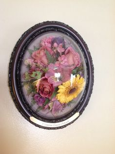 Old fashioned oval frame, flower preservation, dried flowers...beautiful tribute in honor of a loved one www.suspendedintimeoflayton.com Flower Preservation, Curio Cabinets, Oval Frame, How To Preserve Flowers, Dried Flowers, Preserves, Acai Bowl, Beautiful, Food