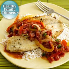 Tilapia Veracruz:  Hot pepper sauce and tomatoes with jalapeno peppers add heat to this baked fish and vegetable dinner recipe served over white rice.