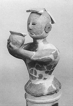 The woman who grinds an offering. Miyagi Japan.   The Kofun period (AD.250-AD.592) art, Haniwa terracotta clay figure.