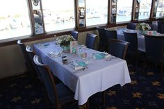 Table setting in main dining room of StarShip II