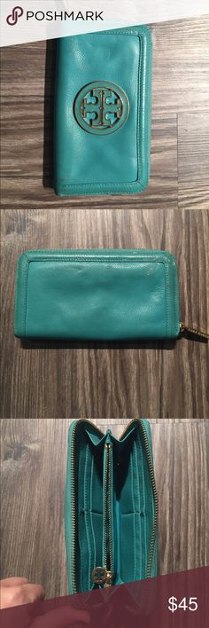 Tory Burch Continental Wallet Turquoise Color Tory Burch Continental Wallet Turquoise Color. Definitely some outside wear to it but still zips great and in great condition on the inside. Tory Burch Bags Wallets