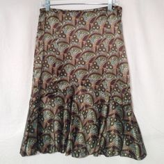 """Ann Taylor LOFT Silk skirt Fully lined 100% silk skirt.  Fairly fitted with a 'mermaid' flare3/4 of the way down.  So soft and pretty.  Hem is finished with grosgrain ribbon hem tape and lining has a side slit.  Hidden back zipper.  Waist is 15.5"""" flat and length is about 25.5"""". Excellent cond. non smoking home.  3rd photo is most accurate for color😊 LOFT Skirts A-Line or Full"""