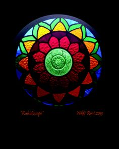 """Kaleidoscope"" by stained glass artist Nikki Root from Utah. This piece features a vintage berry bowl in the center."