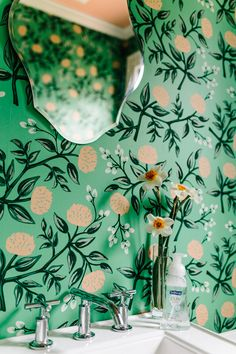 Patterned green floral wallpaper in the bathroom