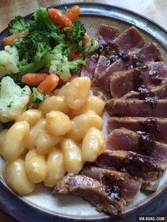 Marinated tuna steak with garlic butter gnocchi and steamed veggies