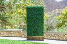 Artificial boxwood hedge panels are being used for weddings, event planning and storefronts!