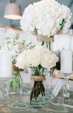 Stunning white blooms in an assortment of vases are so simple yet so effective and very DIY!