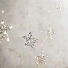 Love these! I would hang them across my window for a rustic Scandinavian Christmas look! Silver star swag led lights. Aff