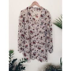 Free People Oversized Floral Blouse Oversized chiffon button down blouse in a beautiful neutral floral pattern. It's a little bit sheer with large billowy sleeves and in perfect condition. Tag says medium but like most Free People items it runs VERY large - could easily fit an XL. Belt it and pair with leggings and boots!  Free People Tops Blouses