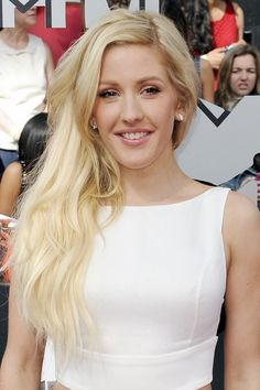 Ellie Goulding wore her blonde waves loose, paired with a pretty make-up look of metallic bronze-toned eyes and pink lipstick.