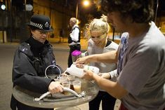 Citizens offer tea to British riot police [London, England, 2011]