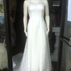"""Wedding Dress fits abt a size 2 light ivory color? About 55"""" in length. Wedding dress is designed from head to toe. Has a train. Beautiful, beautiful pearl buttons in the back, with a zipper as well. It has a button to pull train up at reception, etc. it also is fitted for someone smaller breasted than the model. Model is 35.5"""" round. Needstobe 33"""" This dress has been worn before and needs cleaned. You can tell under the arms and on the underneath/bottom part of the dress. so it will be…"""