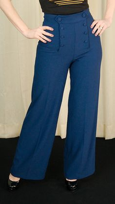 Navy Nelly Bly Sailor Trousers:We're so excited for these sailor pants! These navy blue crepe-like wide leg pants feature eight front buttons that unbutton to reveal a hidden front zipper, they are high waisted and wide. These are perfect for a 40s style look, pair with
