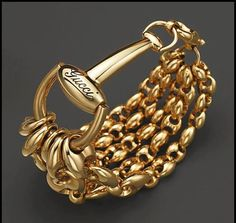 """Gucci """"Marina Chain"""" Bracelet PRICE: $9,900.00 Bold, gleaming horsebits anchor shining chains of 18K yellow gold. By Gucci. •18K yellow gold. Imported. •Lobster clasp closure •6.7""""L"""