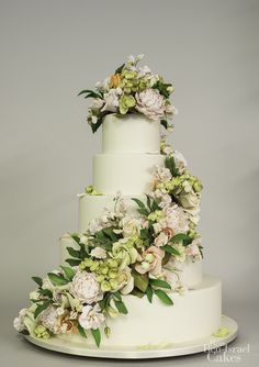Floral wedding cake with peonies, orchids, roses, hydrangea, sweet peas, and foliage. — Ron Ben-Israel Cakes
