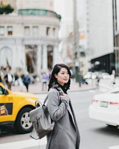 Walked around #SanFrancisco #FinancialDistrict with @thy.time shooting gray outfits on gray buildings on a gray day. —Sharing my latest photoshoot on my blog: www.theorangepatagonia.com (post link in bio) @theorangepatagonia