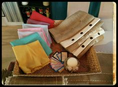 Collection of handmade cushion covers and centerpieces featuring burlap, cloth, dried flowers and candles