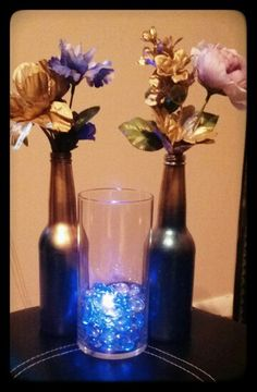 Beer bottle center piece with led lighting in vase.