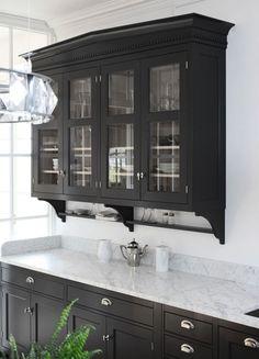 Suzie: Kvanum - Gorgeous kitchen with natural oak glass-front kitchen cabinets painted black ...