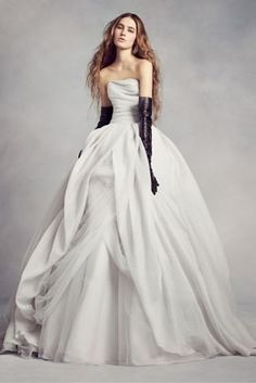 This magnificent textured organza wedding dress from White by Vera Wang features a flattering draped bodice and an asymmetrical skirt with a split-front overlay. A modern dress for a dream day.  White by Vera Wang, exclusively at David's Bridal  Polyester Sweep train Back zipper; fully lined Dry clean Imported Also available in extra length