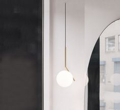 """IC S1 belongs to a collection of ceiling lamps, table lamps and wall lamps, designed by Michael Anastassiades for Flos.  This collection originated from a suggestion by the designer had Anastassiades, while watching the video of a juggler who was perfoming in a dynamic number with spheres. The creativity of Anastassiades has gone further, and has """"fixed"""" the spheres, giving life to this original line of lamps."""