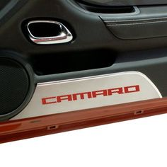 """Camaro Carbon Fiber Kick Plates. These brushed stainless steel door panel kick plates add a clean, modern look to your Camaro with their carbon fiber inlays. Made from 100% stainless steel, they will not tarnish, fade or rust. Easy """"peel and stick"""" installation takes just minutes. Fits all 2010-2013 coupe and convertible Camaros. Made in the USA. Set of 2."""