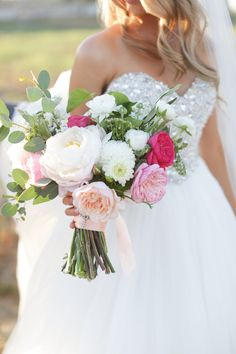 Bridal bouquet of pink garden roses, white peonies and ranunculus. White wedding dress with jeweled boddess. Cute Outdoor wedding. Design by Mayberry Events and Flowers by Mulberry&moss. Photography by Alders.