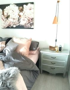 Bedroom in shades of grey and blush pink with rose gold and copper highlights. Copper bedside lights hanging from mini copper elephants! Beautiful Thomas Darnell canvas too!