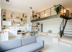 School teachers' lounge transformed into contemporary loft apartment