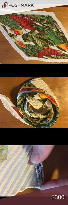 NWOT Hermès plisse silk scarf Les Parroquets This beautiful Hermès pleated silk scarf has been sitting in my closet for over a decade, never worn.  I somehow managed to lose the box in which it came, but I am the original owner.  The colors are shades of olive green, red and orange on a creamy white  background. I will entertain offers for this item. Hermes Accessories Scarves & Wraps