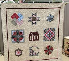my first quilt, a sampler of hand pieced blocks
