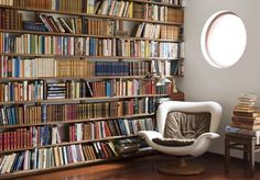 the chair.  the porthole window. the book shelving
