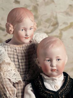 Right: Rare German bisque character boy by Gebrüder Heubach, marked 7759 Heubach (square) Germany, Left: Rare German smiling character girl by Gebruder Heubach, circa 1912, marked Heubach (sunburst) 7852 Germany.