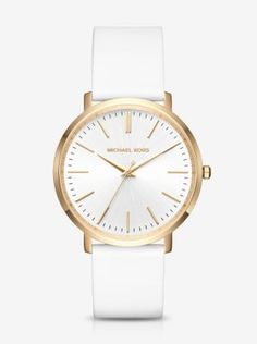 Exclusively Ours in Michael Kors stores and on michaelkors.com until 7/30/16. Exceptionally sleek and streamlined, this polished timepiece features a slim-profile silhouette that gives it a minimalist look and feel. With a luxe silicone strap and polished gold-tone stainless steel case, our Jaryn watch offers a fresh take on an essential accessory.