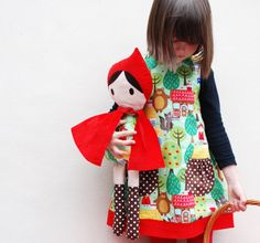 A beautiful girls dress in a red riding hood fairytale print. An easy to wear simple fun dress for little girls and babies which coordinates