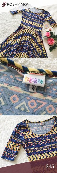 """LuLaRoe Nicole dress Beautiful blue&yellow print Nicole dress by LuLaRoe. New With Tags, size Small. Buttery soft and stretchy fabric. Full circle skirt. Measures: bust flat 16.5""""// waist flat 13""""// sleeve 12""""// shoulder to bottom 38.5"""". **has a small marking on the inside size tag, doesn't affect the look or function.** Please ask questions 💫 LuLaRoe Dresses"""