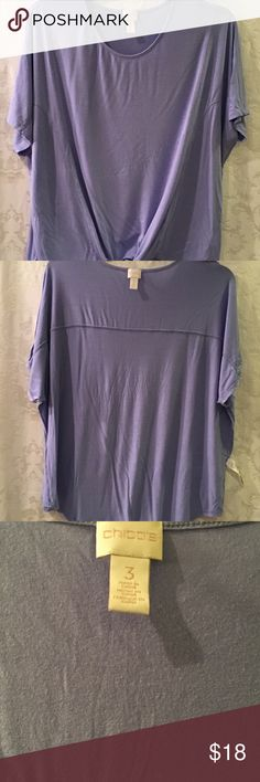 Chico's Short Sleeve sz3. Reg XL or 16. Chico's Lilac Short Sleeve Oversized Tie Front T Shirt Size 3. Conventional size is XL or size 16. The shirt has short sleeves with a round collar. Very good condition.  Thank you for viewing my product. If you have any questions please contact me. Chico's Tops Tees - Short Sleeve