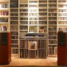 Vinyl wall of sound records living room player turntable