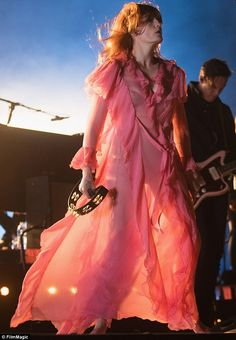 Sheer genius:Florence Welch flashed her bra and briefs in a billowing pink frock as she p...