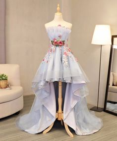 Handmade item Material:Satin, tulle Made to order Color:Refer to image Processing time:15-25 business days Delivery date:5-10 business days Dress code:E0331 Fabric:Satin, tulle Embellishment: Flower appliques Straps:Strapless Sleeves:Sleeveless Silhouette:A-line Neckline: Refer to i