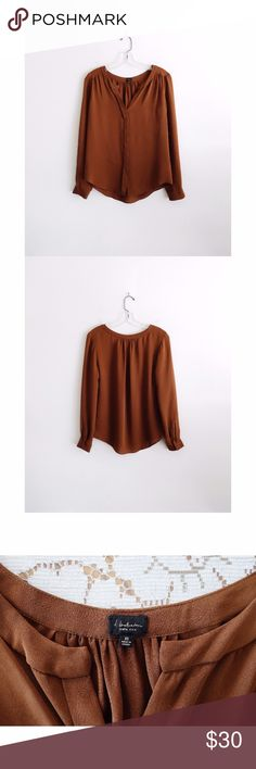 """Aritzia Babaton Bergen Brown Silk Blouse sz XS Aritzia T. Babaton 'Bergen' Warm Brown Toffee Silk Split Neck Long Sleeve Blouse size Extra Small, gently used--no rips or holes, light signs of wear, needs to be dry-cleaned, one stain at back of collar--see pic 4, split neckline, button down front, covered placket, pleating at back of collar and front shoulders, long sleeves with covered single button cuffs, curved shirttail hem, 100% silk, 15.5-16"""" across shoulders, 19"""" pit to pit, 22""""…"""