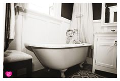 LOT116 PHOTOGRAPHY Baby in bathtub, b