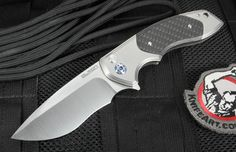 """Custom Rod Olson JV Gemini 3.5"""" tactical folding knife designed by Jared Van Otterlew. Amazing attention to fit, finish and detail on this knife. Razor sharp stainless CPM 154 steel blade with a re-curve design. Integral flipper makes this knife open with ease, right or left handed. Bearing pivot is smooth and lightning fast. Handle has a secure button lock. Blasted titanium frame is integral with carbon fiber inlays. Handle and carbon fiber inlays are triple stepped for contour and handle…"""