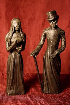 Voodoo, Maman Brigitte et Baron Samedi - these custom made statues sit on our altar.                                                                                                                                                     More