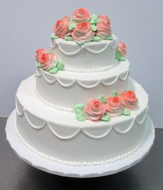 Beautiful tiered wedding cake with pink buttercream roses