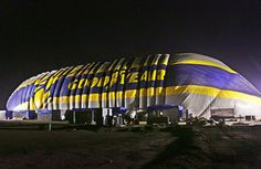 New Blimp Hangar being inflated. - The Goodyear Tire & Rubber Company inflated a 337-foot-long hangar at its Carson blimp base along the I-405 freeway during the overnight hours. The new structure will serve as the home of Goodyear's newest blimp, Wingfoot Two, which began operating in Los Angeles in October.
