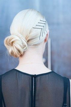 Low side bun with styled V bobby bins