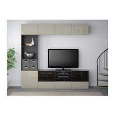 IKEA - BESTÅ, TV storage combination/glass doors, black-brown/Selsviken high gloss/beige smoked glass, drawer runner, soft-closing, , The drawers and doors close silently and softly, thanks to the integrated soft-closing function.You can control your electronic equipment with the doors closed, as the remote control works through the glass.The space-saving wall shelves make the most of the wall area above your TV.It's easy to keep the cords from your TV and other devices out of sight but…